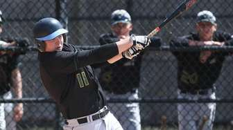 Ward Melville's Phil Carballera (11) takes a swing