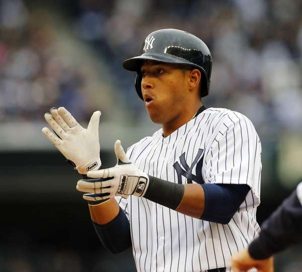 Yangervis Solarte reacts after his fourth-inning RBI single
