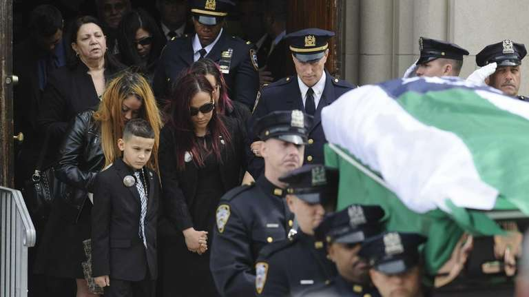 Family members follow the coffin carrying the remains