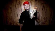 Chef-owner Jimmy Lian -- with a salmon over