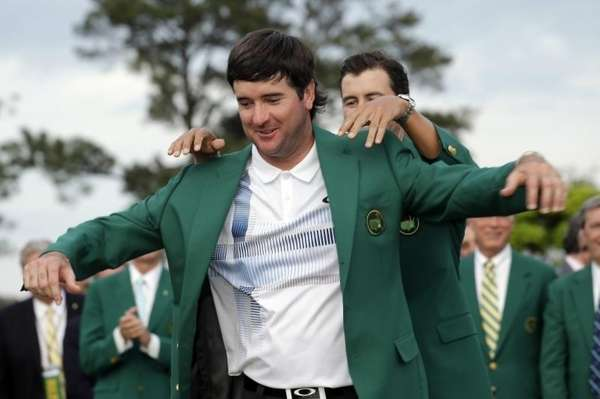 Defending Masters' champion Adam Scott, of Australia, helps