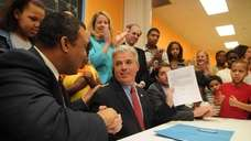 Suffolk County Executive Steve Bellone, holding a new