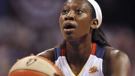 The Connecticut Sun's Tina Charles shoots a free