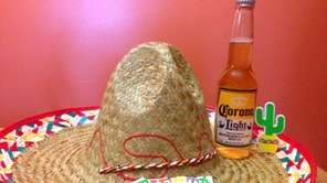 A sombrero, along with a cerveza (Spanish for