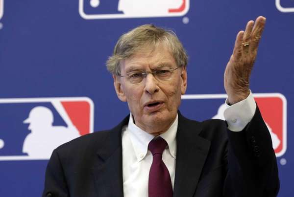 MLB commissioner Bud Selig answers a question during