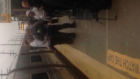 Long Island Rail Road riders wait at the
