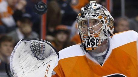 Philadelphia Flyers' Steve Mason catches a shot during