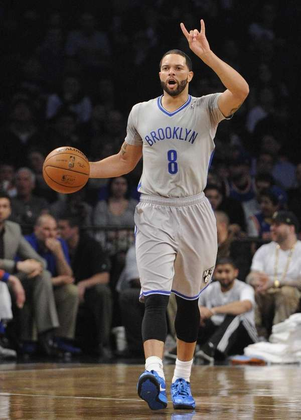 Nets guard Deron Williams calls a play against