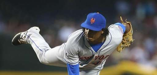 Starting pitcher Jenrry Mejia of the Mets pitches