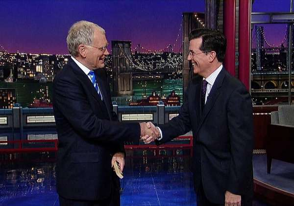 "David Letterman, left, with Stephen Colbert of ""The"