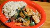 Thai basil tofu, with peppers, carrots and onions