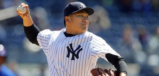 Masahiro Tanaka delivers a pitch in the first