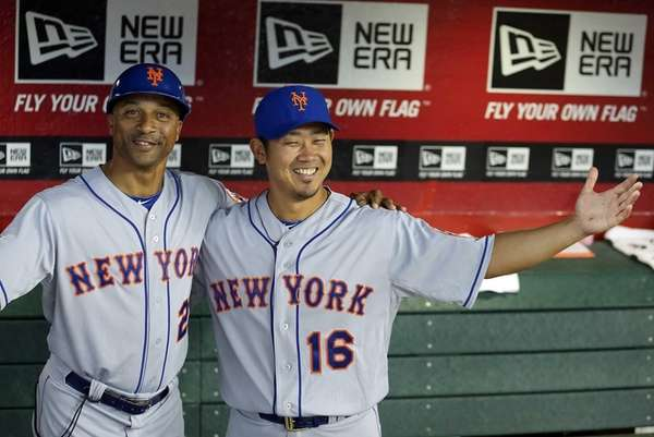 Pitcher Daisuke Matsuzaka, right, of the Mets poses