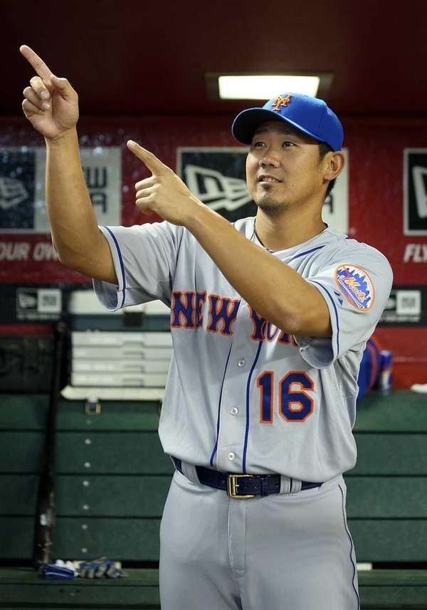 Daisuke Matsuzaka stands in the dugout before a