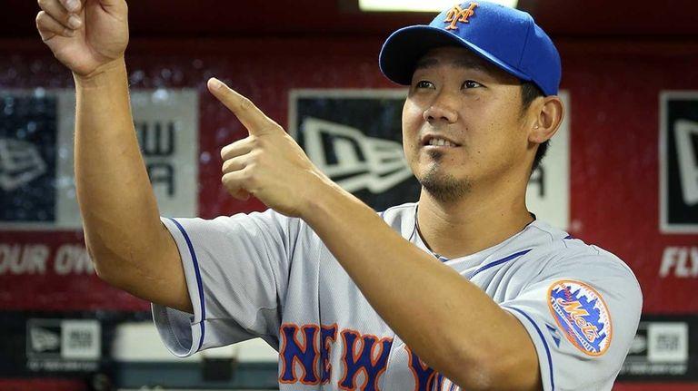 Daisuke Matsuzaka stands in the dugout before a