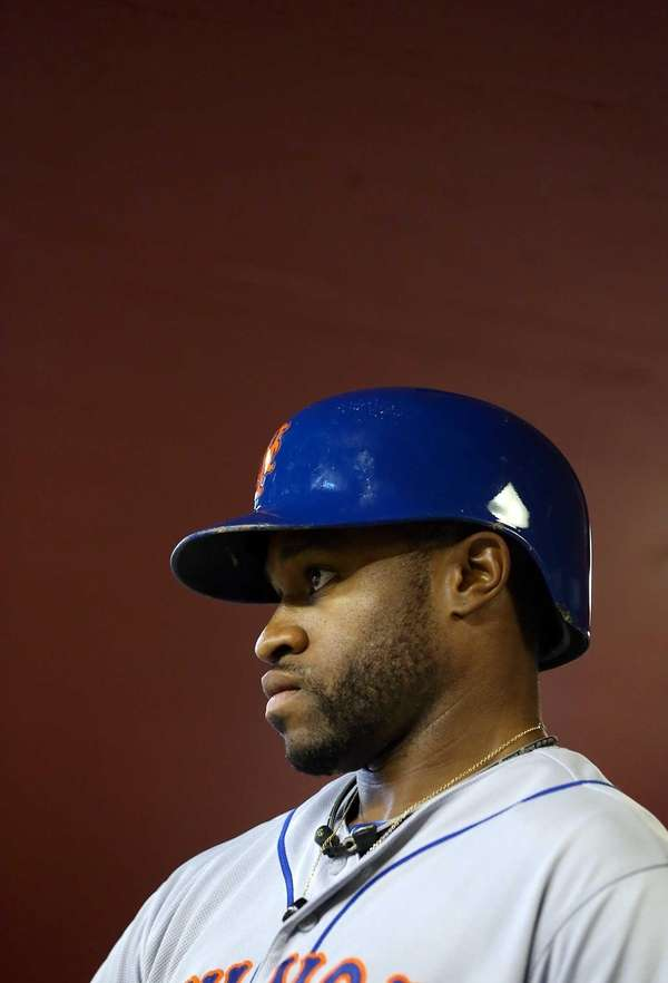 Eric Young Jr. stands in the dugout before