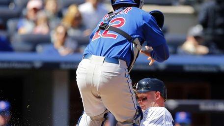 Brian McCann of the Yankees scores a fourth