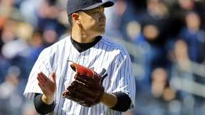 Masahiro Tanaka reacts after the final out of
