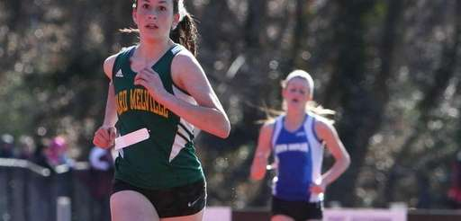 Alesia Muklebust of Ward Melville pulls away from