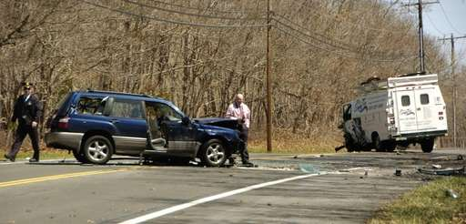 Police investigate the scene of an accident on