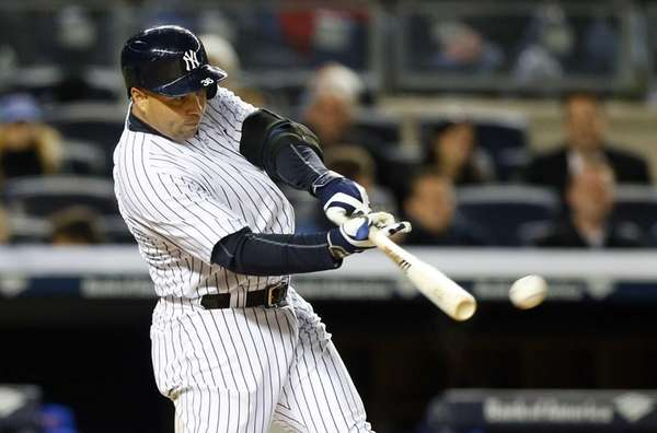Carlos Beltran of the Yankees connects on a