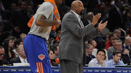 Knicks head coach Mike Woodson claps leading into