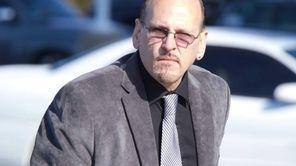 Dennis Halstead arrives at federal court in Central
