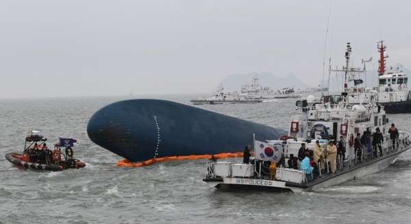South Korean Coast Guard officers search for missing