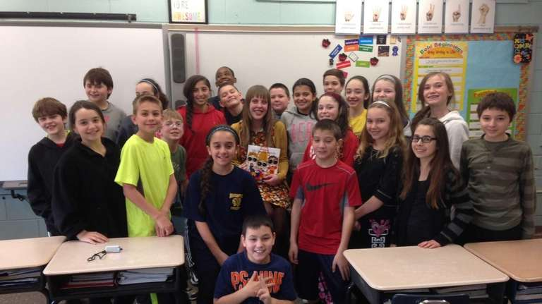 Author Paige Snider, center, surrounded by the students