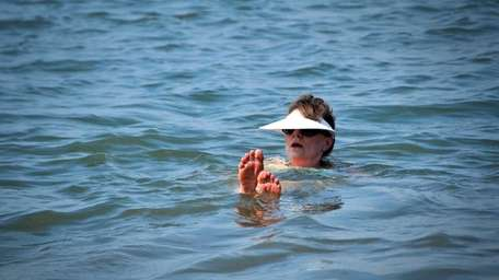 A woman beats the heat while floating in