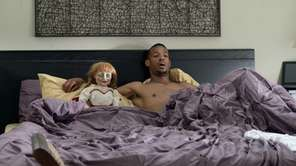 """Abigail"" and Marlon Wayans as ""Malcolm"" appear in"