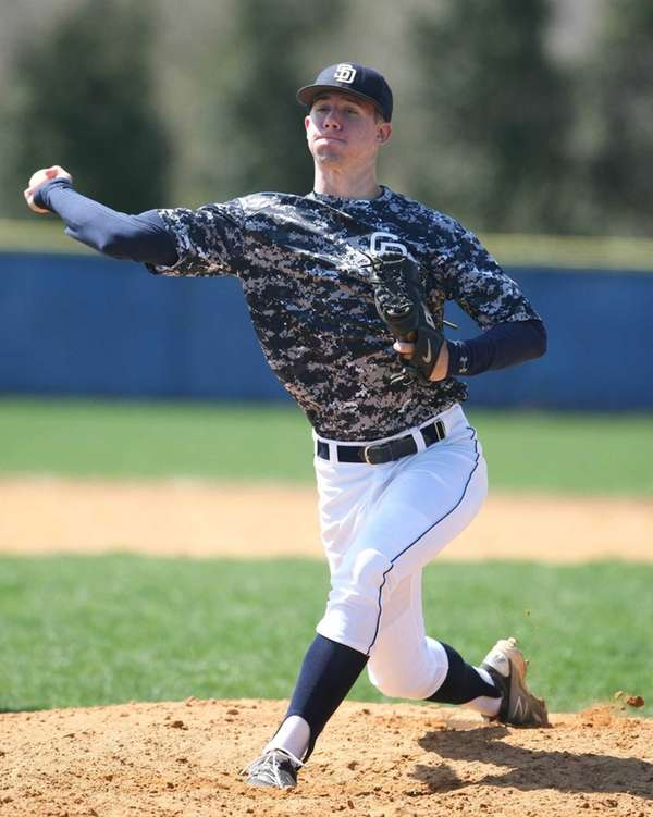 Brady Renner (11) of St. Dominic's winds up