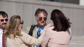 John Restivo talks with Heather Halstead and Melissa