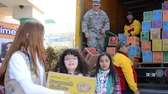 Nassau County Girl Scouts load boxes of cookies