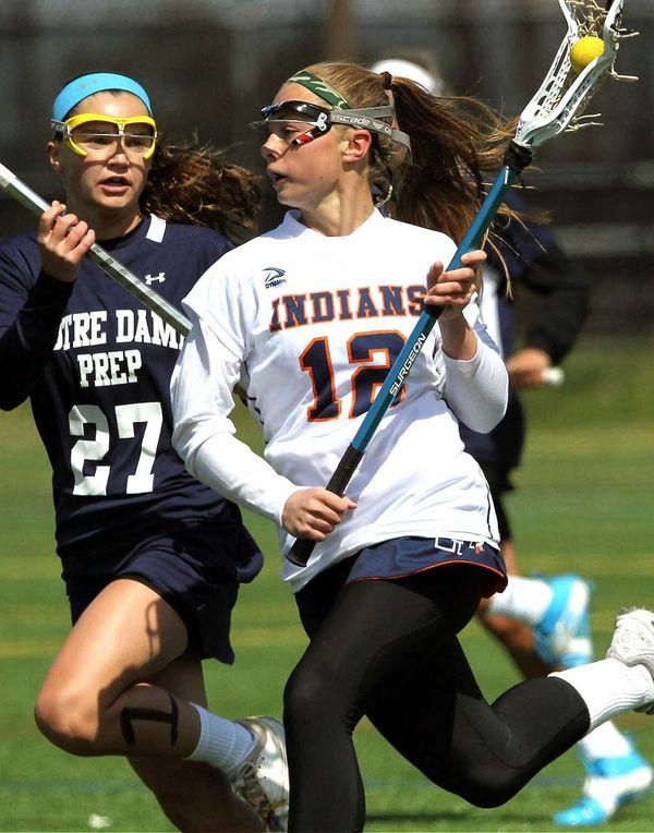 Manhasset's Lindsay Ronbeck gets covered by Notre Dame's