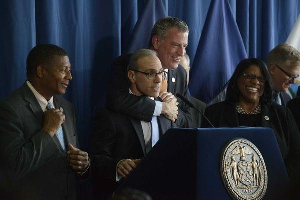 Mayor Bill de Blasio jokingly restrains Staten Island