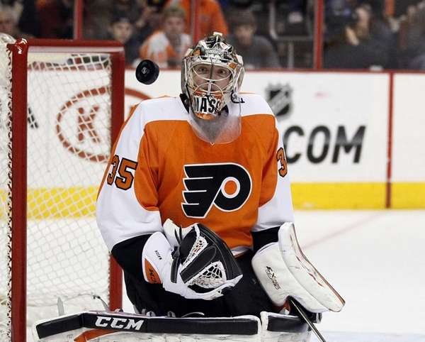 Philadelphia Flyers goalie Steve Mason watches the puck