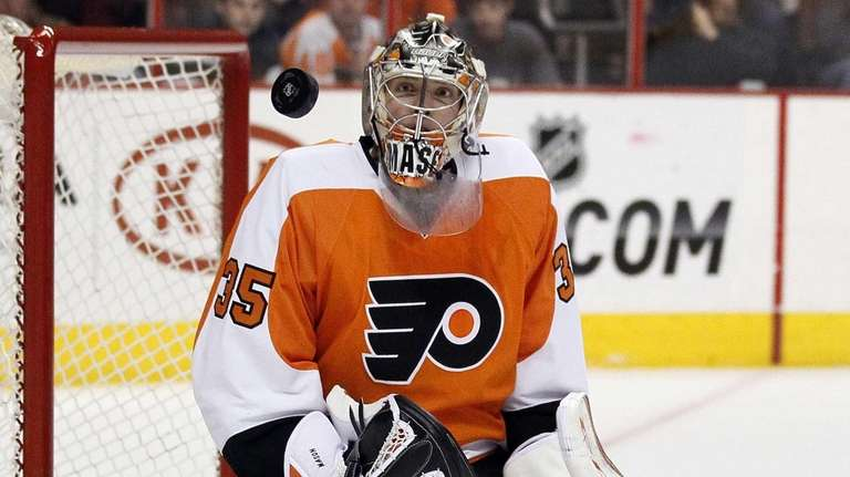 Philadelphia Flyers goalie Steve Mason watches the puck