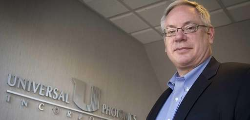Universal Photonics' president Neil Johnson at his office