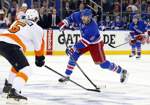 Rick Nash of the Rangers takes a shot