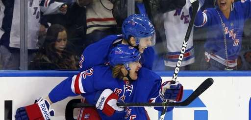 Carl Hagelin of the Rangers celebrates his third-period