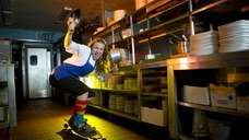 Executive chef Heather West rides her skateboard through