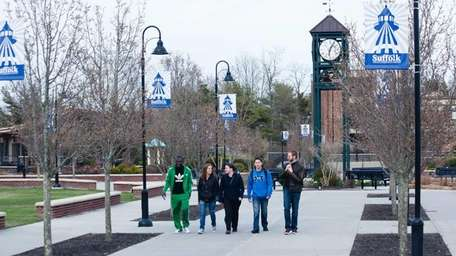 A group of students walk across the campus