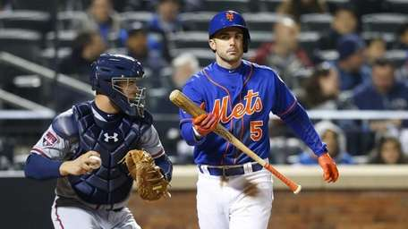 David Wright of the Mets strikes out in