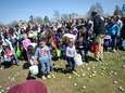 Children and their families dash for eggs during
