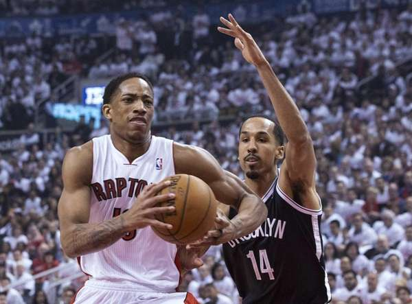 Toronto Raptors' DeMar DeRozan, left, drives on Nets'