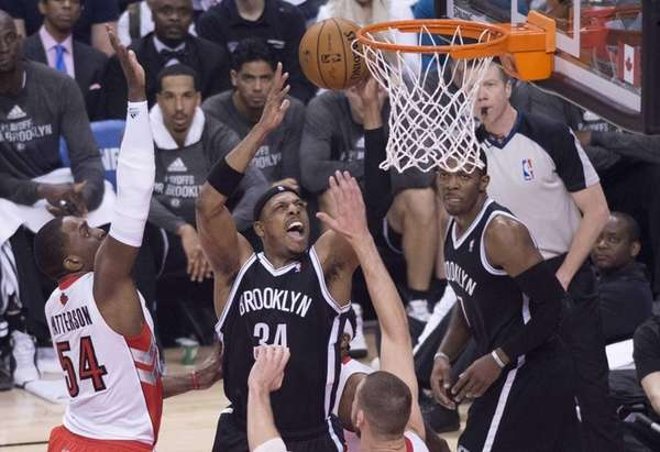 Nets' Paul Pierce, center, drives to the net