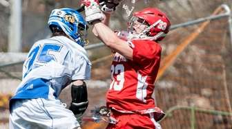 Smithtown East goalie Billy McEnroe tries to make