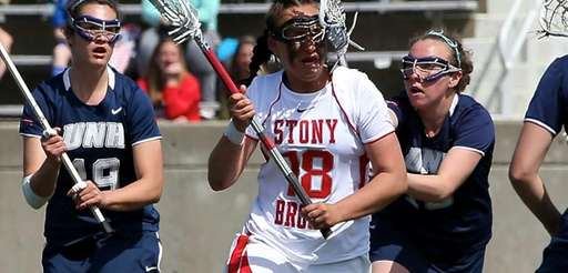 Stony Brook's Courtney Murphy takes a stick to
