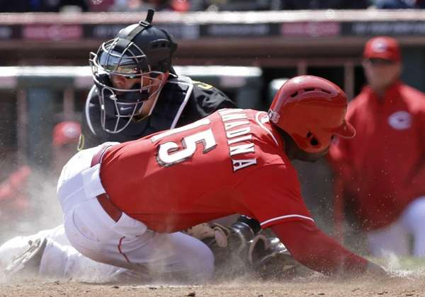 Cincinnati Reds' Roger Bernadina is tagged out at